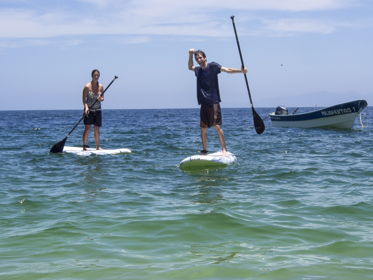 Erin and Simon paddleboarding in Mexico